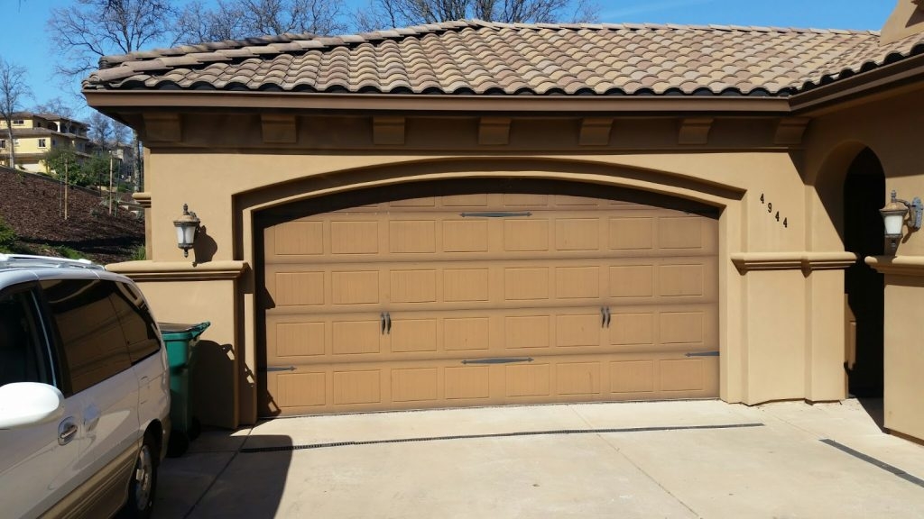 Garage door installation archives sugar land garage door they look fine in need of some new paint maybe the doors had been pounded with the hot texas sun for years and they were pretty weathered solutioingenieria Choice Image