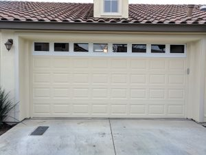 added panel to garage door with windows