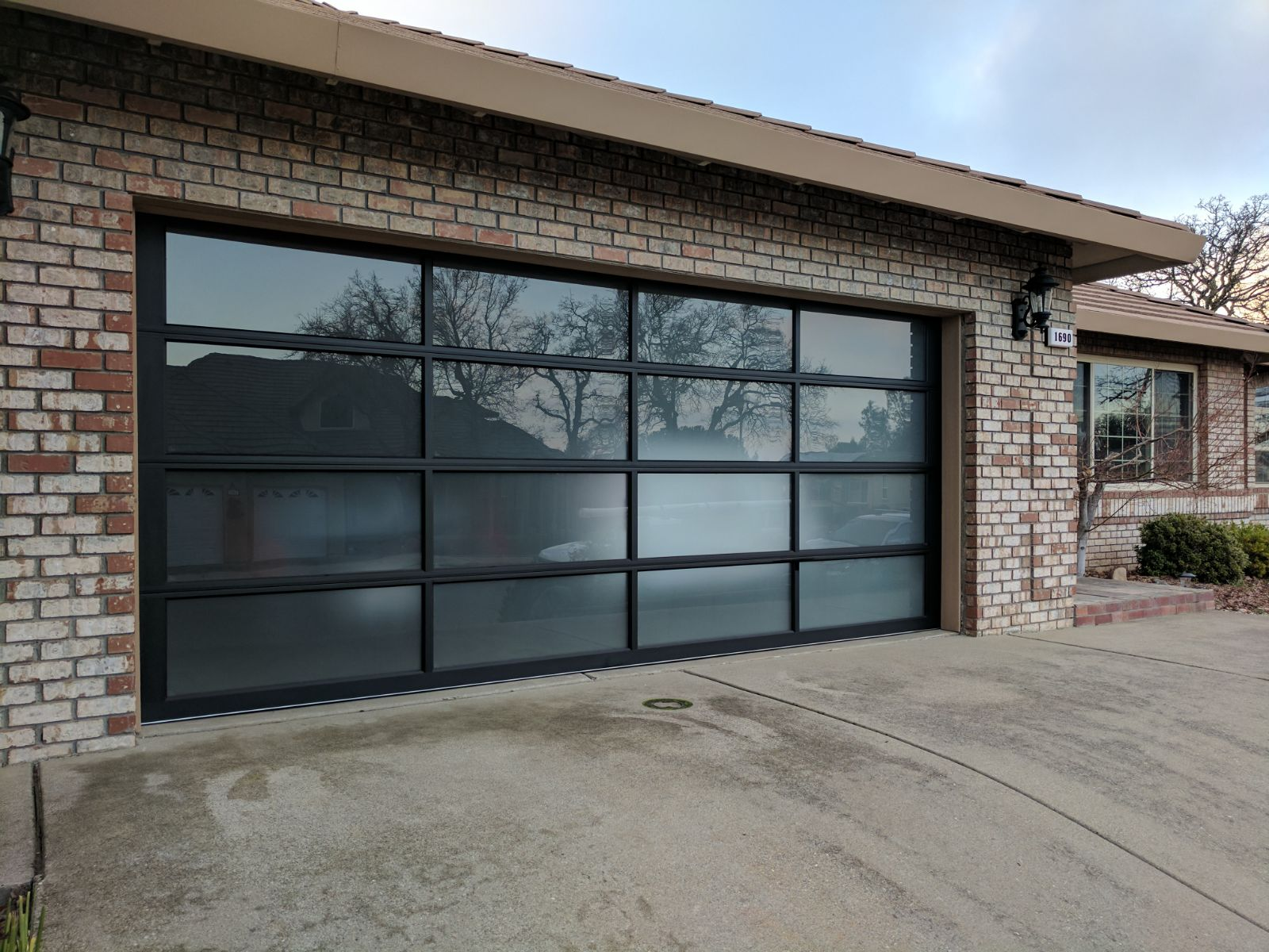 tinted doors northwest ltd anodized clear modern door collection classic glass residential garage canada