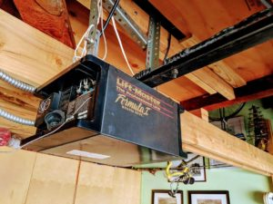 A very old garage door opener.